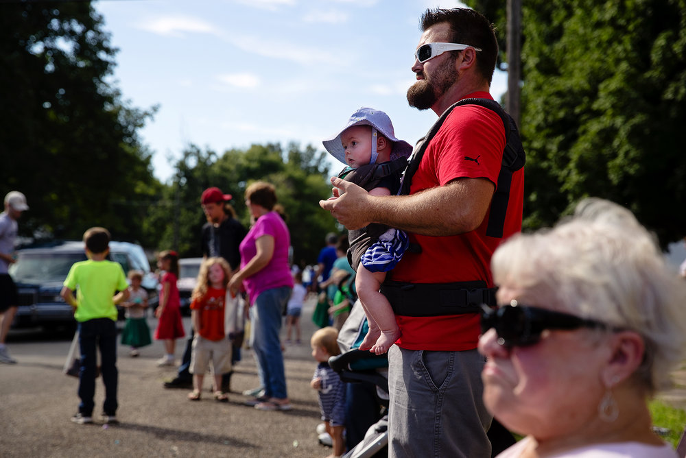Jeremy Hendricks and his four-month-old daughter Maggie watch the 50th Annual Greenview Labor Day Celebration Monday, Sept. 3, 2018. [Ted Schurter/The State Journal-Register]