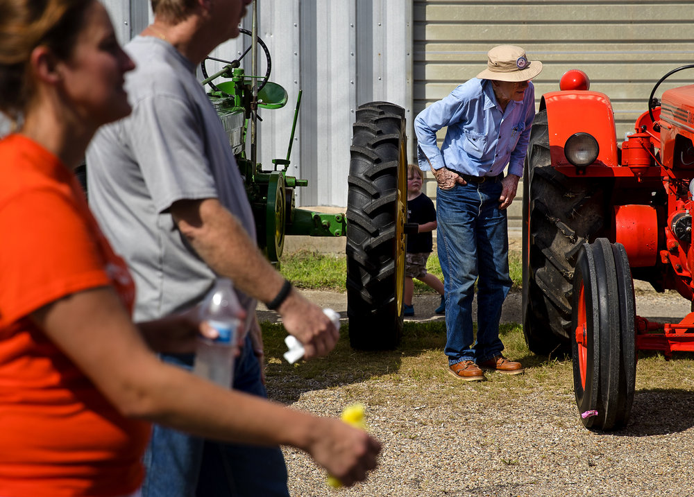 Fred Markert inspects onf of the antique tractors on display after driving his own, a 1957 Oliver Super 55, in the parade during the 50th Annual Greenview Labor Day Celebration Monday, Sept. 3, 2018. [Ted Schurter/The State Journal-Register]