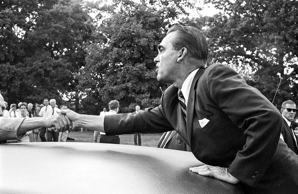Former Alabama Gov. George Wallace shakes hands with a supporter after laying a wreath at Lincoln's Tomb in Oak Ridge Cemetery in Springfield, Ill. Sept. 12, 1968. Wallace stopped in Springfield to campaign for president as an independent. Wallace made a speech to 3,000 to 4,000 people at Capital Airport, then laid a wreath at Lincoln's Tomb in Oak Ridge Cemetery. File/Bill Hagen/The State Journal-Register