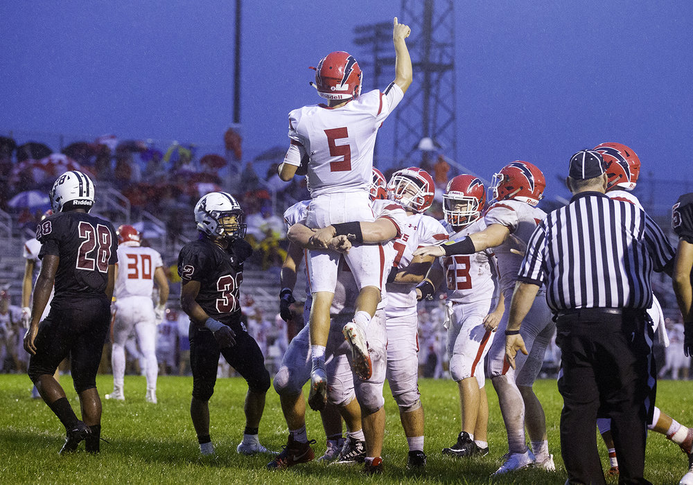 Glenwood's Luke Lehnen is hoisted into the air to celebrate his first quarter touchdown against Springfield at Memorial Stadium Friday, Sept. 7, 2018. [Ted Schurter/The State Journal-Register]