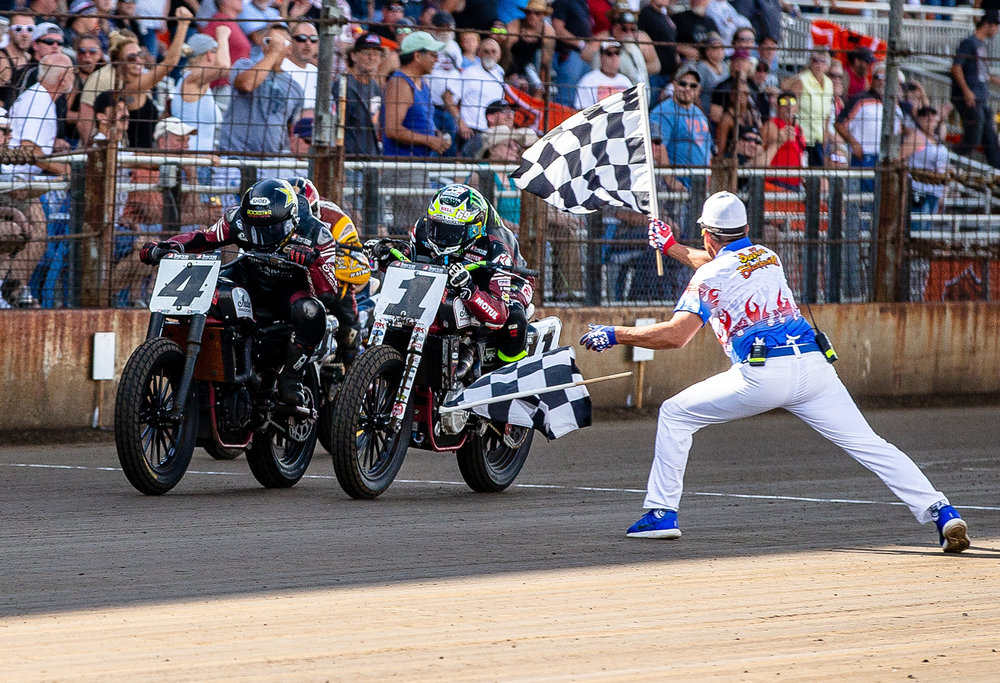 Bryan Smith, left, beats Jared Mees, right, by .013 seconds as they take the checkered flag on their Indian Scout FTR750s during the American Flat Track Springfield Mile II at the Illinois State Fairgrounds, Sunday, Sept. 2, 2018, in Springfield, Ill. [Justin L. Fowler/The State Journal-Register]