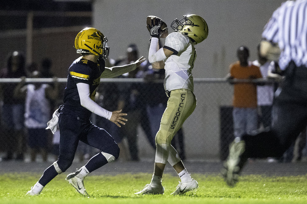 Sacred Heart-Griffin's Isaiah Thompson grabs a touchdown pass in front of Southeast's Isaiah Sexton at Southeast High School Friday, Sept. 14, 2018. [Ted Schurter/The State Journal-Register]