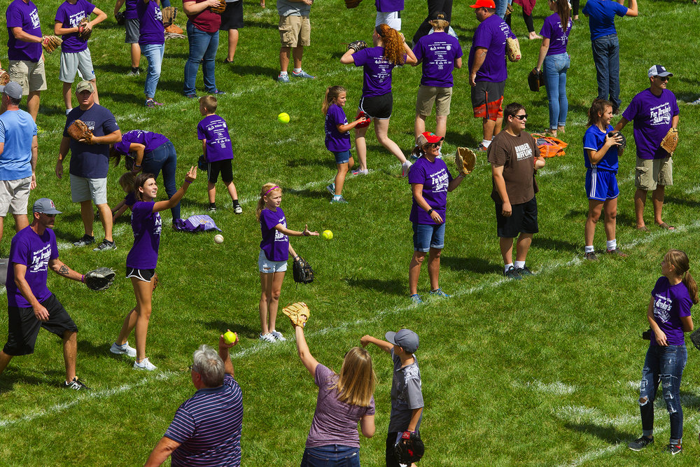 "Participants play catch on the football field at Pleasant Plains High School during the ""For Drake's Sake World Record Attempt for the Largest Game of Catch"" Sunday, Sept. 9, 2018. More than 950 people had signed up in advance to play catch to raise funds to benefit the family of Drake Lucas, the infant son of Darren and Jill Lucas. Drake was diagnosed with Hurler syndrome, a rare genetic disorder, shortly after birth. [Ted Schurter/The State Journal-Register]"