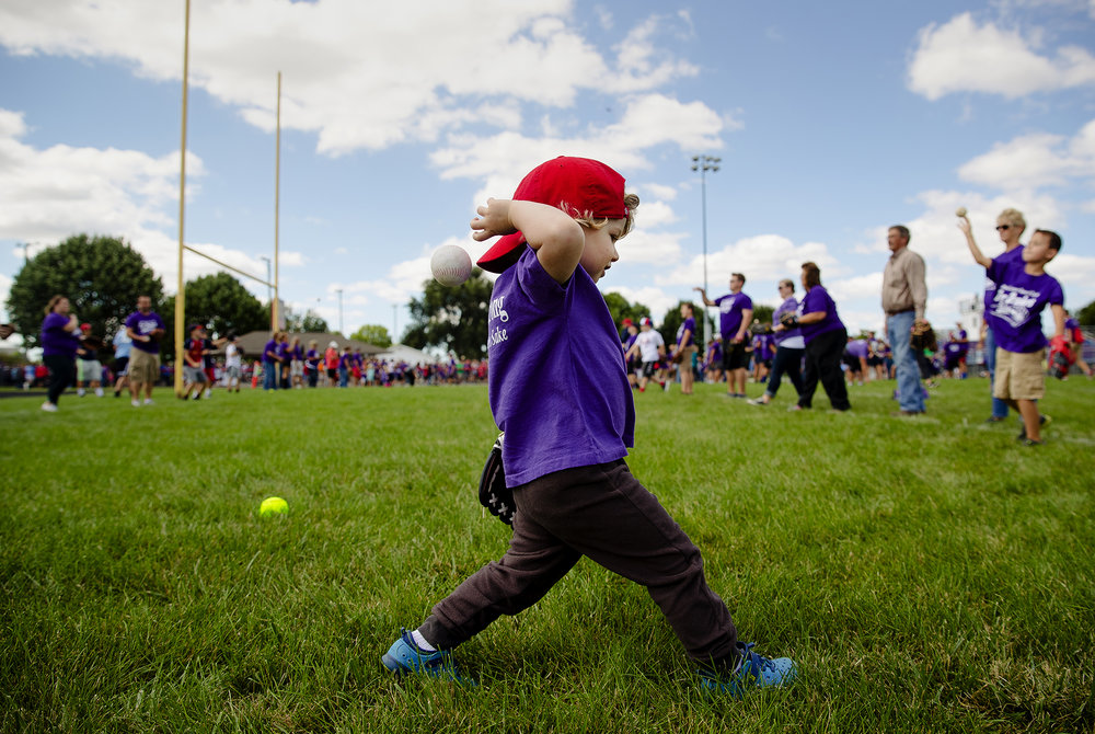 "Two-year-old Leo Lucas attempts a throw during the  ""For Drake's Sake World Record Attempt for the Largest Game of Catch"" Sunday, Sept. 9, 2018. More than 950 people had signed up in advance to play catch to raise funds to benefit the family of Drake Lucas, the infant son of Darren and Jill Lucas. Drake was diagnosed with Hurler syndrome, a rare genetic disorder, shortly after birth. [Ted Schurter/The State Journal-Register]"