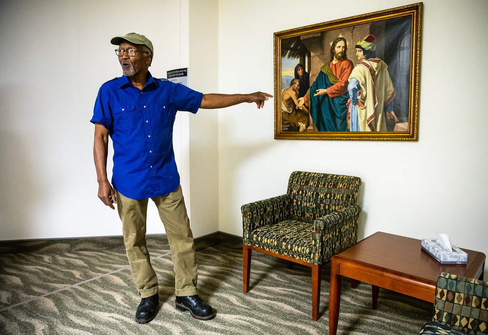 "Artist Preston Jackson is moved by seeing a copy of the painting ""Christ and the Rich Young Ruler"" hanging in the Chiara Center that he remembers vividly from his youth while on a tour to learn more about the Hospital Sisters of St. Francis' role in caring for the victims in the 1908 Race Riot that his has been commissioned to depict in a painting that will be in the new HSHS St. John's Hospital Women and Children's Clinic, Tuesday, Sept. 11, 2018, in Springfield, Ill. ""I can't express the emotion,"" Jackson said of seeing the painting from his youth. ""I grew up with that picture, it's like another person beside me. I'm not even five years old and thats how far I'm going back and here is the art that I was exposed to. I could never think of where it came from, you know my interest in art, and that was it and especially it was that painting.""  [Justin L. Fowler/The State Journal-Register]"