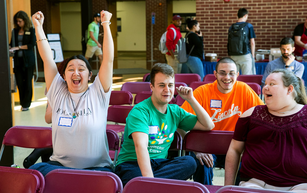 "Cloie Kim celebrates after winning a point in a Family Feud trivia game at Lincoln Land Community College during the Logger Activities Board ""Game Show Day"" in honor of Constitution Day Monday, Sept. 17, 2018. The event featured games, voter registration and deep-fried Oreos. [Ted Schurter/The State Journal-Register]"