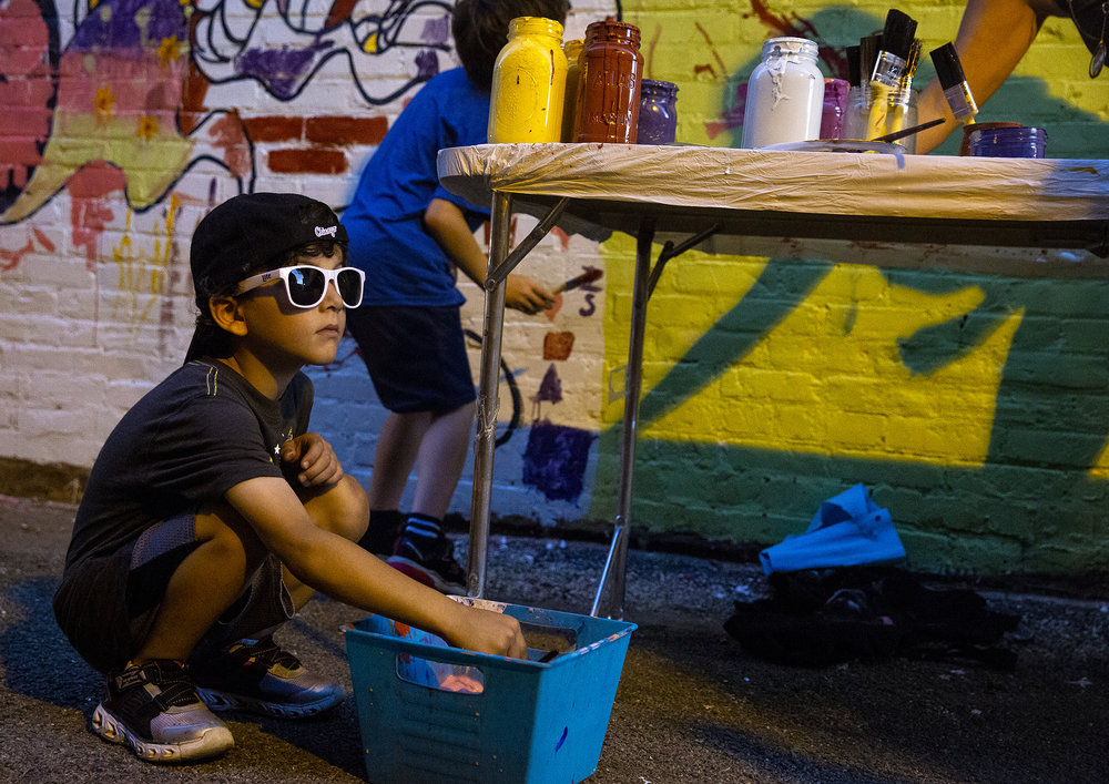 Zanden Stoeff, 6, rinses his brush before working on the community-created mural at the Downtown Springfield Inc.'s Art Alley II pop-up event Thursday, Sept. 20, 2018 in the alley between Fourth and Fifth streets near the Old State Capitol Springfield, Ill. [Rich Saal/The State Journal-Register]
