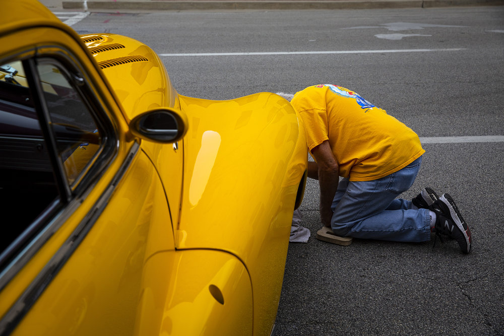 "Dennis Montgomery puts a polish on his smooth yellow 1948 Chevy at The International Route 66 Mother Road Festival Friday, Sept. 21, 2018 Springfield, Ill. Montgomery says the car once belonged to his grandmother. ""I grew up in this car."" It had 59,000 miles on it when he got it, and it was gun metal gray. Montgomery has customized it, and says his grandmother wouldn't never recognize it. [Rich Saal/The State Journal-Register]"
