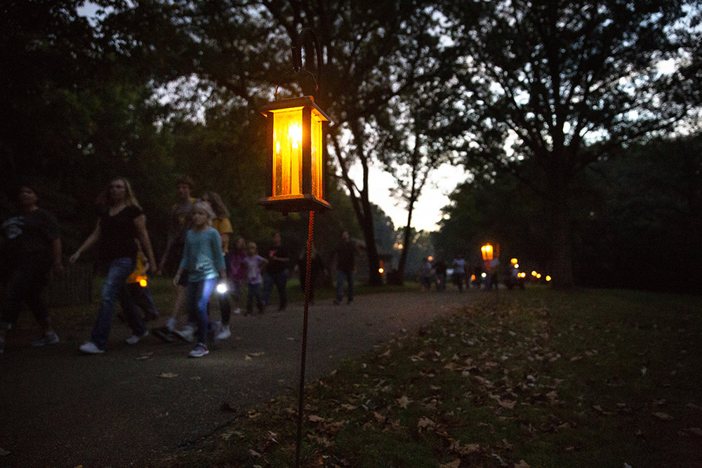 Visitors stroll through Lincoln's New Salem State Historic Site during their annual candlelight tour Friday, Oct. 5, 2018  in Petersburg, Ill. [Rich Saal/The State Journal-Register]