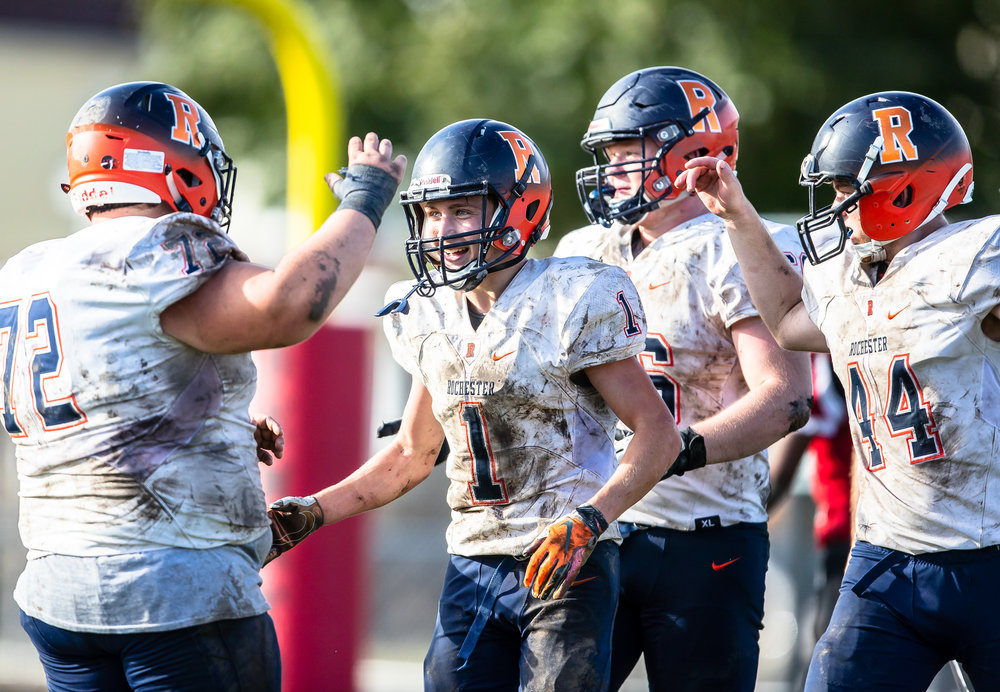 Rochester's Riley Lewis (1) gets congratulated by his teammates after a 39 yard touchdown catch against Springfield in the second half at Memorial Stadium, Saturday, Oct. 6, 2018, in Springfield, Ill. [Justin L. Fowler/The State Journal-Register]