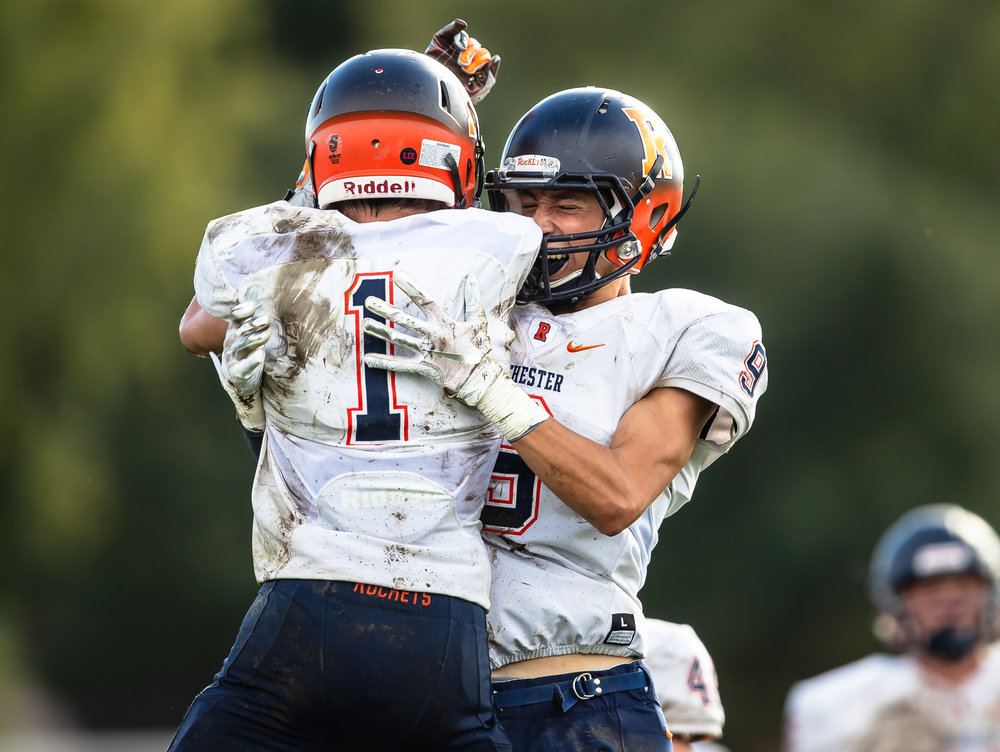 Rochester's Riley Lewis (1) celebrates his touchdown with Rochester's Clayton Cornett (9) in the second half against Springfield at Memorial Stadium, Saturday, Oct. 6, 2018, in Springfield, Ill. [Justin L. Fowler/The State Journal-Register]