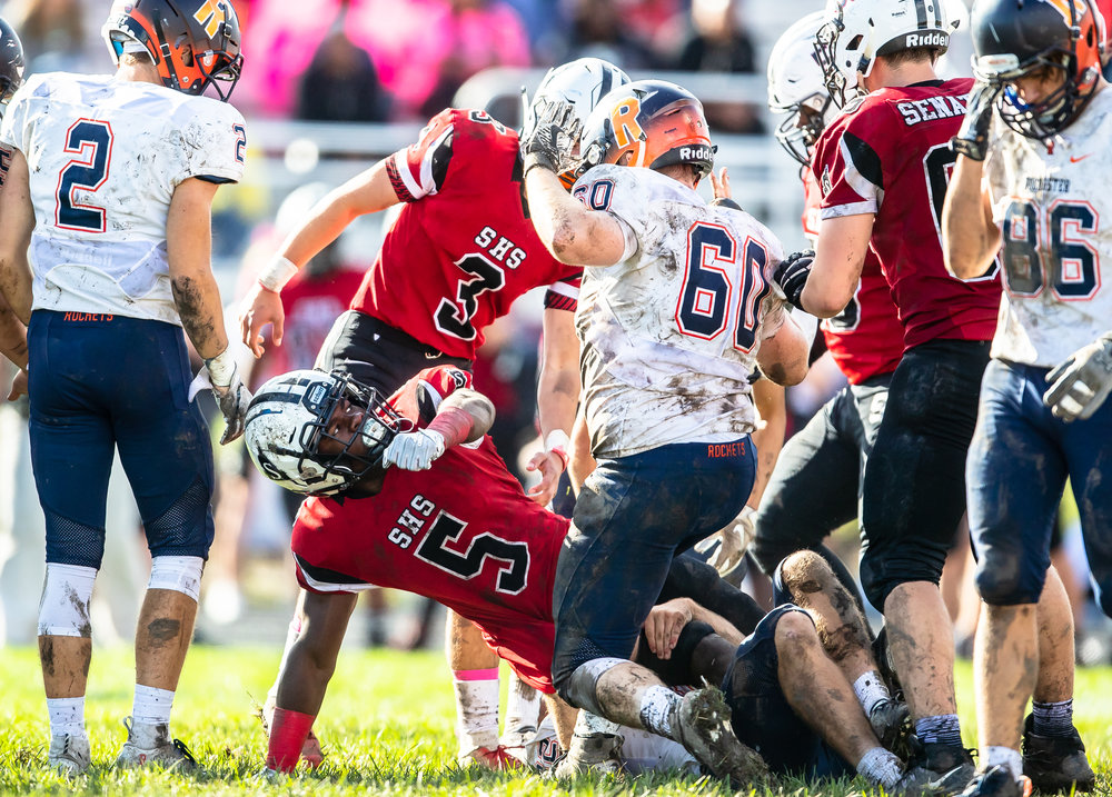 Players get chippy after the whistle after Springfield's Justin Bivins II (5) is brought down by Rochester's Dalton Garecht (60) in the second half at Memorial Stadium, Saturday, Oct. 6, 2018, in Springfield, Ill. [Justin L. Fowler/The State Journal-Register]