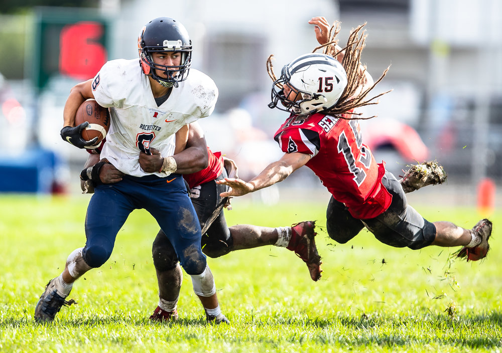 Rochester's Hank Beatty (8) is brought down by Springfield's Caleb Small (11) as he tries to gain yardage after a catch in the second half at Memorial Stadium, Saturday, Oct. 6, 2018, in Springfield, Ill. [Justin L. Fowler/The State Journal-Register]