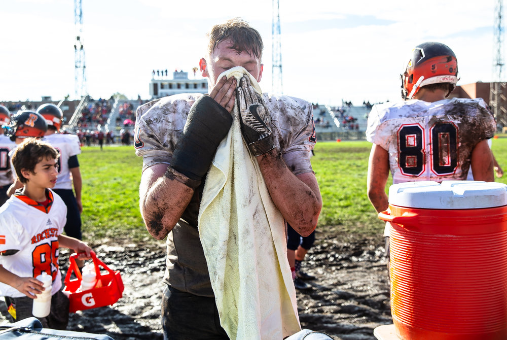 Rochester's Dalton Garecht (60) tries to clear the mud from his face along the sidelines as the Rockets take on Springfield at Memorial Stadium, Saturday, Oct. 6, 2018, in Springfield, Ill. [Justin L. Fowler/The State Journal-Register]