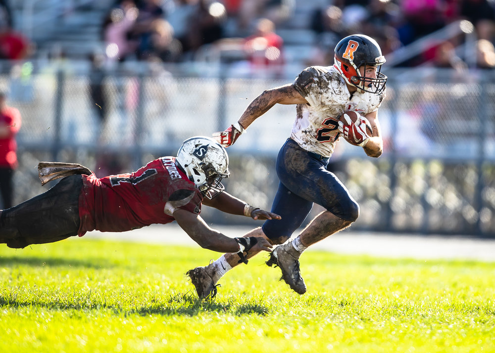 Rochester's David Yoggerst (21) sheds a tackle from Springfield's Caleb Small (11) on his way to a touchdown in the second half at Memorial Stadium, Saturday, Oct. 6, 2018, in Springfield, Ill. [Justin L. Fowler/The State Journal-Register]
