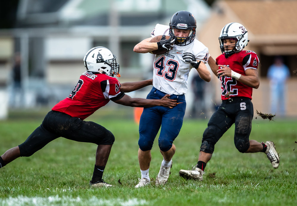 Rochester's Jacob Durocher (43) bursts through a tackle from Springfield's Jeffery Elms (9) on a run against Springfield in the first half at Memorial Stadium, Saturday, Oct. 6, 2018, in Springfield, Ill. [Justin L. Fowler/The State Journal-Register]