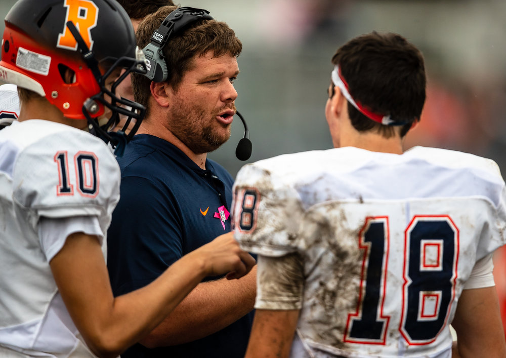 Rochester head coach Derek Leonard talks to his quarterbacks as the Rockets take on Springfield at Memorial Stadium, Saturday, Oct. 6, 2018, in Springfield, Ill. [Justin L. Fowler/The State Journal-Register]