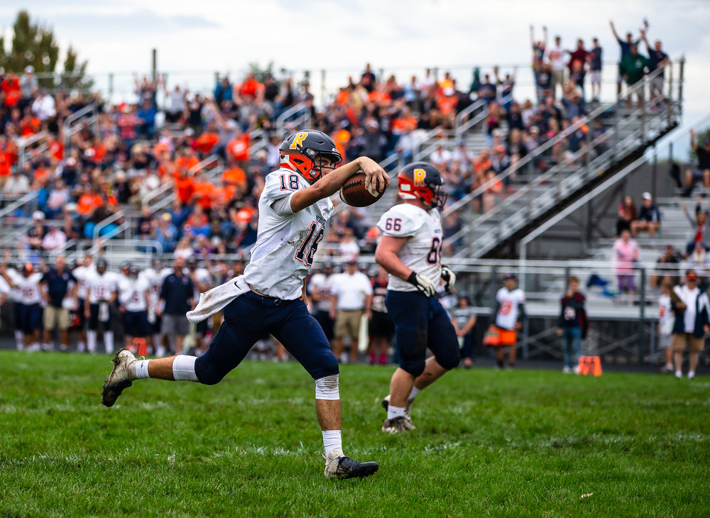 Rochester quarterback Clay Bruno (18) goes in for a rushing touchdown against Springfield in the first half at Memorial Stadium, Saturday, Oct. 6, 2018, in Springfield, Ill. [Justin L. Fowler/The State Journal-Register]