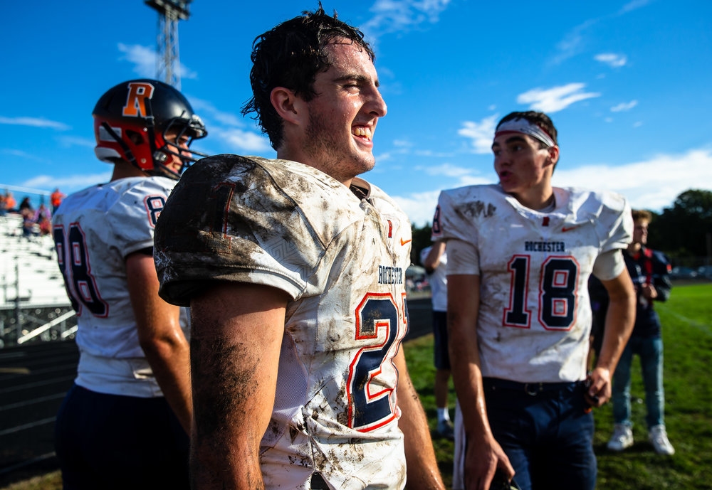 Rochester's David Yoggerst (21) joins the Rockets on the sidelines after a muddy day on the field as Rochester gets a running clock on Springfield in the second half at Memorial Stadium, Saturday, Oct. 6, 2018, in Springfield, Ill. [Justin L. Fowler/The State Journal-Register]
