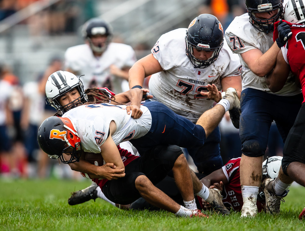 Springfield's Xavier Cooper (15) brings down Rochester's David Yoggerst (21) on a rush in the first half at Memorial Stadium, Saturday, Oct. 6, 2018, in Springfield, Ill. [Justin L. Fowler/The State Journal-Register]