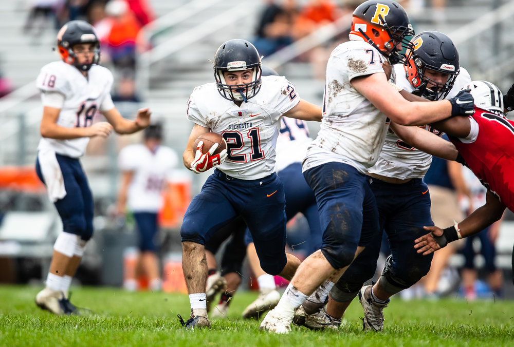 Rochester's David Yoggerst (21) follows a block on a rush against Springfield in the first half at Memorial Stadium, Saturday, Oct. 6, 2018, in Springfield, Ill. [Justin L. Fowler/The State Journal-Register]