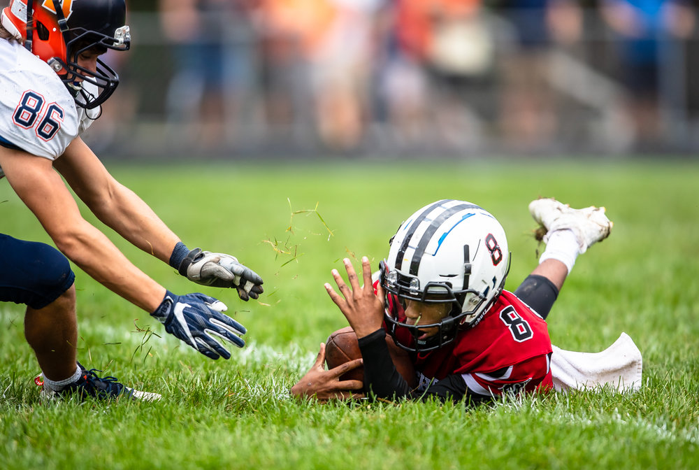 Springfield quarterback Rashad Rochelle (8) scoops up a fumbled ball to keep it away from Rochester's Ethan Vose (86) in the first half at Memorial Stadium, Saturday, Oct. 6, 2018, in Springfield, Ill. [Justin L. Fowler/The State Journal-Register]