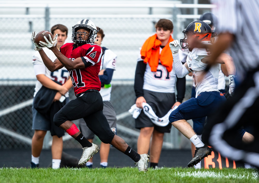 Springfield's John Waddy (81) catches a pass down the sideline on his way to a touchdown against Rochester in the first half at Memorial Stadium, Saturday, Oct. 6, 2018, in Springfield, Ill. [Justin L. Fowler/The State Journal-Register]