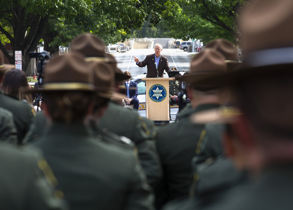 Gov. Bruce Rauner addresses a crowd gathered for the Illinois State Police Memorial Park dedication ceremony Tuesday, Oct. 2, 2018 at 615 W. Lawrence in Springfield, Ill. [Rich Saal/The State Journal-Register]