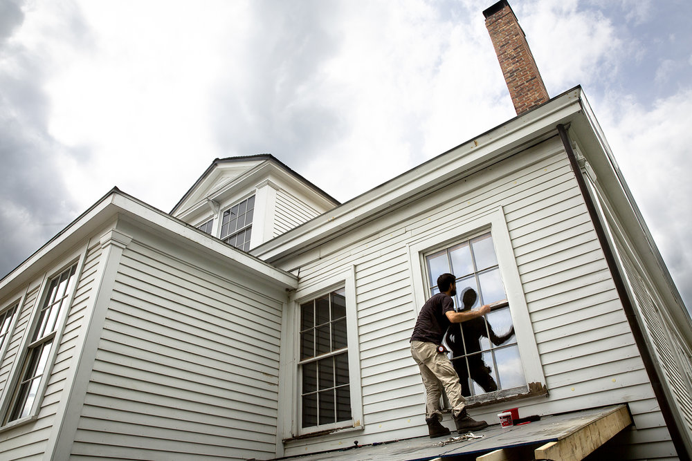 Ken Hawkinson reglazes windows on the historic Iles House at Seventh and Cook streets Monday, Oct. 1, 2018 in Springfield, Ill. The work is part of a project to repair and repaint windows, build a slope to improve rain runoff over two previously flat roofs on the back side of the house, and seeding and irrigating a dirt lot. The house was built around 1837 for Elijah Iles, who helped settle Springfield. It is the oldest surviving house in Springfield and is listed on the National Register of Historic Places. [Rich Saal/The State Journal-Register]
