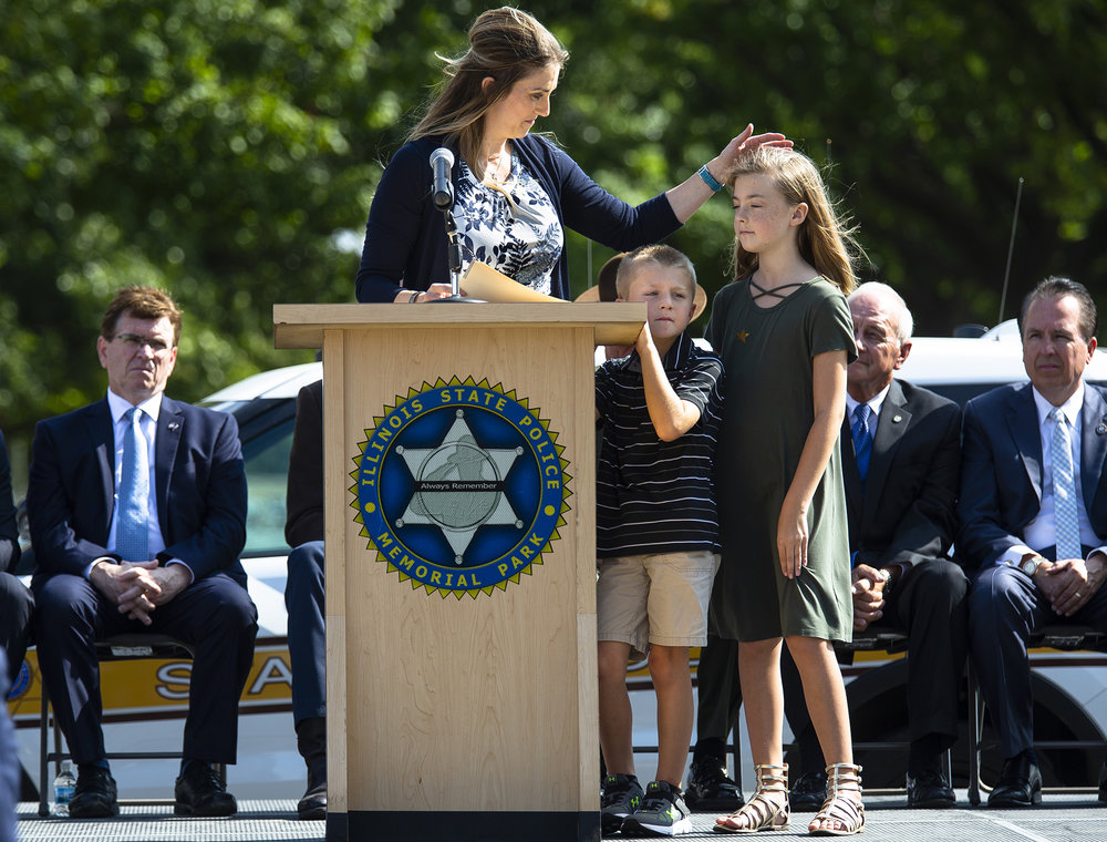Sarah Deatherage-Steele, the widow of Trooper Kyle Deatherage, delivered remarks on behalf of Gold Star families, and was accompanied by her children, Camden, 6, and Kaylee, 10, during the Illinois State Police Memorial Park dedication ceremony Tuesday, Oct. 2, 2018 at 615 W. Lawrence in Springfield, Ill. [Rich Saal/The State Journal-Register]