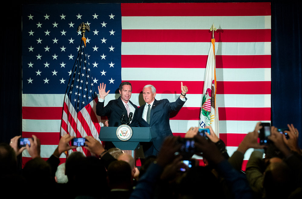 Vice President Mike Pence, right, campaigns for Rodney Davis, R-Taylorville, at Panther Creek Country Club in Springfield, Ill., Friday, Oct. 12, 2018. Davis is locked in a nationally watched race for the 13th Congressional District against Democrat Betsy Dirksen Londrigan of Springfield.  [Ted Schurter/The State Journal-Register]