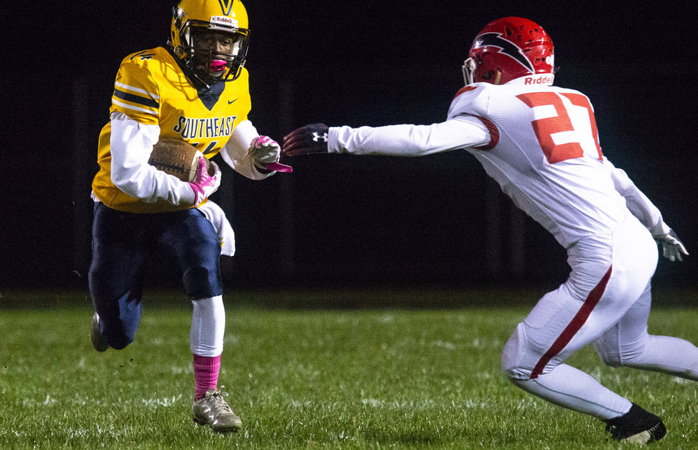 Southeast's Antron Bevly faces Glenwood defender Austin Bush Friday, Oct. 12, 2018 at Southeast High School's Spartan Field in Springfield, Ill. [Rich Saal/The State Journal-Register]