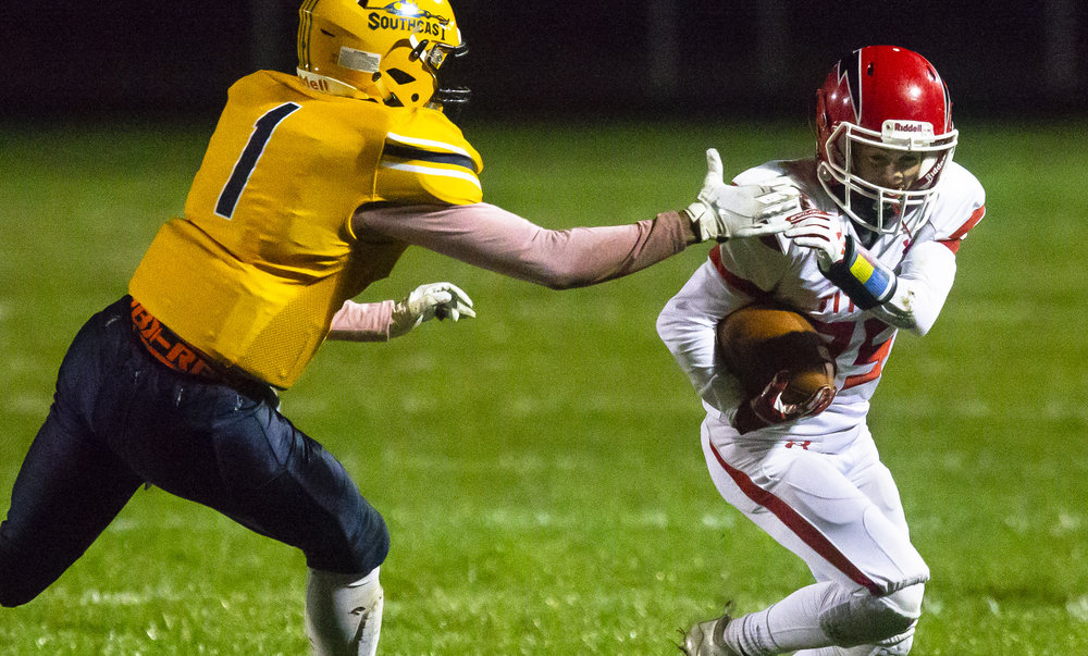 Southeast's Isaiah Cooper reaches for Glenwood's Jakob Crabtree Friday, Oct. 12, 2018 at Southeast High School's Spartan Field in Springfield, Ill. [Rich Saal/The State Journal-Register]