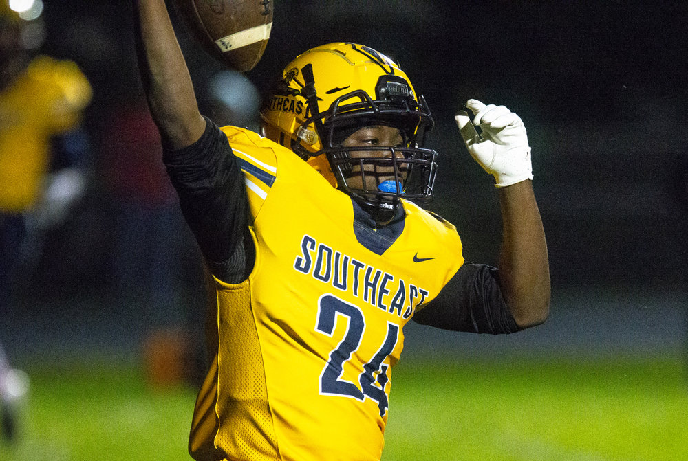 Southeast's Brian Kirkham celebrates a second quarter touchdown Friday, Oct. 12, 2018 at Southeast High School's Spartan Field in Springfield, Ill. [Rich Saal/The State Journal-Register]