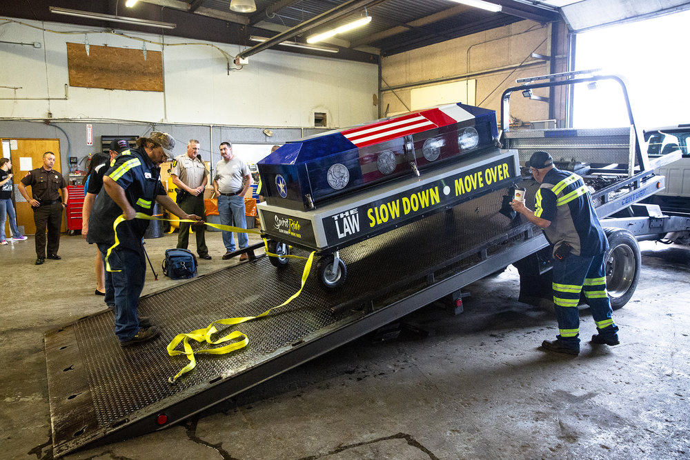 Employees of Shaner's Towing secure a ceremonial casket known as Spirit, onto a tow truck following an event to raise awareness of Mover Over, Slow Down laws that protect first responders and tow operators on roadways Wednesday, Oct. 10, 2018 at Shaner's Towing in Springfield, Ill. The Spirit Ride relay procession began in April on the east coast and uses more than 10,000 tow trucks to transport the casket across the country. In December, tow truck operator Ronald Chaney of Springfield was struck and killed on I-72 between MacArthur Boulevard and Veterans Parkway while picking up a disabled automobile. The event is organized by American Towman Spirit, Inc. [Rich Saal/The State Journal-Register]