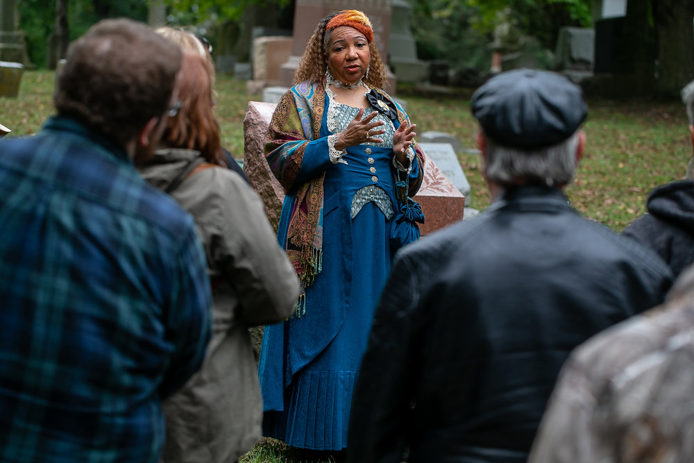 "Roni Betts portrays Martha Hicklin as she tells the story of how she came to Springfield in the 1860s with her husband, Hezkiah, and came to be the Vice President of the Illinois State Colored Historical Society during the Sangamon County Historical Society's ""Echos of Yesteryear: A Walk through Oak Ridge Cemetery"" at the cemetery, Sunday, Oct. 14, 2018, in Springfield, Ill. [Justin L. Fowler/The State Journal-Register]"