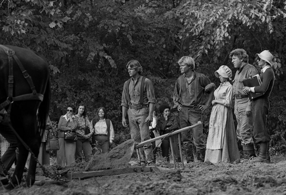 "In period clothing, from left, actors James van Patten, Brian Kerwin, Stacey Nelkin and Robert Preston prepare for a scene during filming for the television mini series ""The Chisholms"" at New Salem State Historic Site, October 2, 1978. File/Bill Hagen/The State Journal-Register"