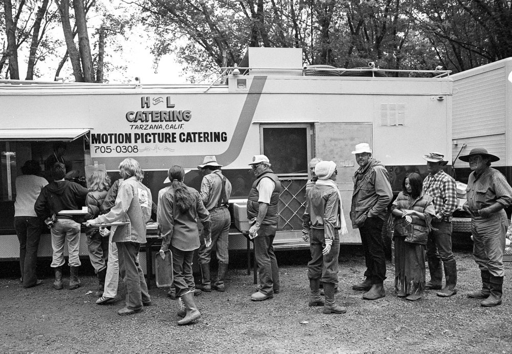 "The crew and actors, including lead actor Robert Preston, right, line up for lunch during the filming of the television mini series ""The Chisholms"" at New Salem State Historic Site, October 2, 1978. File/Bill Hagen/The State Journal-Register"