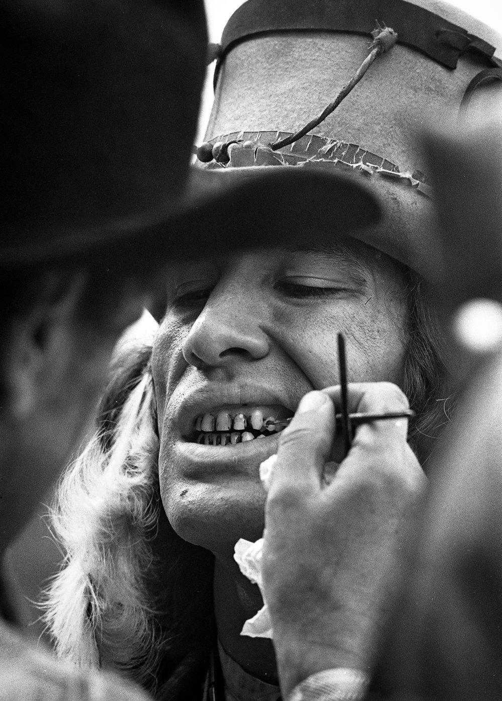 "Indian Gino Silva gets a set of grimy teeth during filming for the television mini series ""The Chisholms"" at New Salem State Historic Site, October 2, 1978. File/Bill HagenThe State Journal-Register"