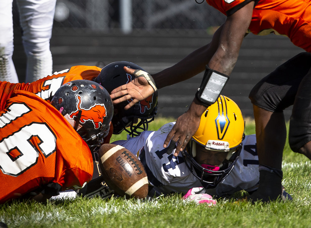Lanphier teammates scramble for a ball knocked away from Southeast's Antron Bevly at Memorial Stadium Saturday, Oct. 20, 2018 in Springfield, Ill. Lanphier recovered the fumble. [Rich Saal/The State Journal-Register]