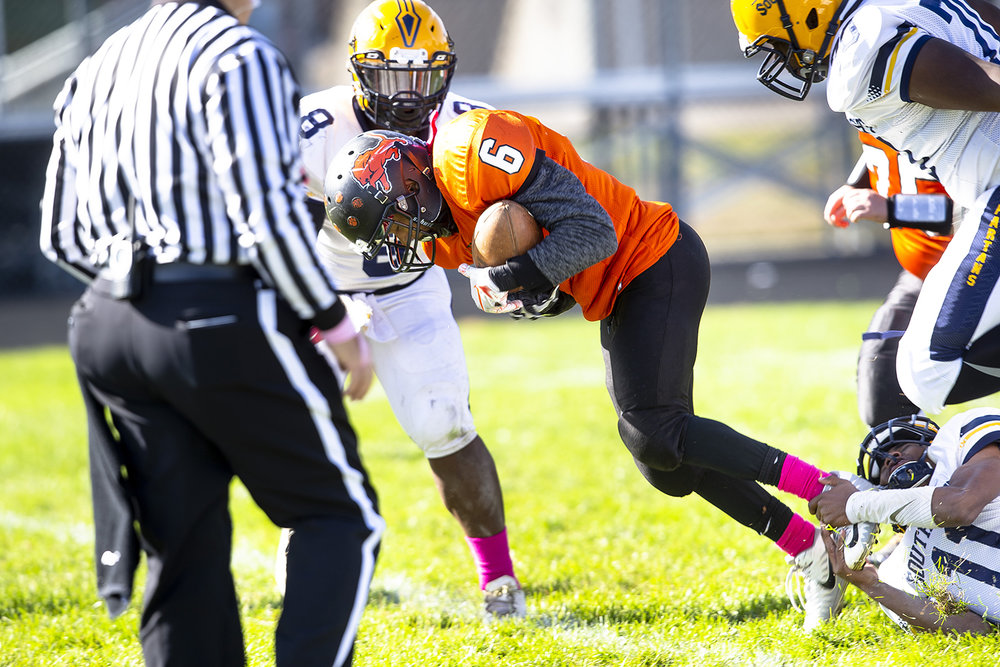 Lanphier's Jacxon Blakey can't escape the grasp of Southeast's Cameron Tillman at Memorial Stadium Saturday, Oct. 20, 2018 in Springfield, Ill. [Rich Saal/The State Journal-Register]
