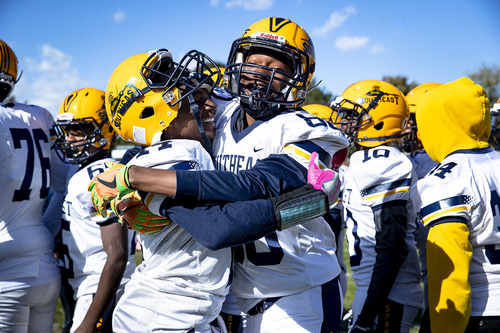 Southeast's Antron Bevly, left, and Karlous Perry Jr. celebrate their 44-12 win over Lanphier at Memorial Stadium Saturday, Oct. 20, 2018 in Springfield, Ill. [Rich Saal/The State Journal-Register]