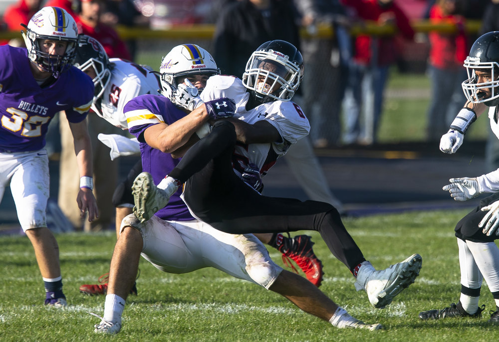 Williamsville's Keegan McGann tackles DuQuoin's Dasani Edward in the Class 3A playoff game Saturday, Oct. 27, 2018 at Paul Jenkins Field in Springfield, Ill. [Rich Saal/The State Journal-Register]