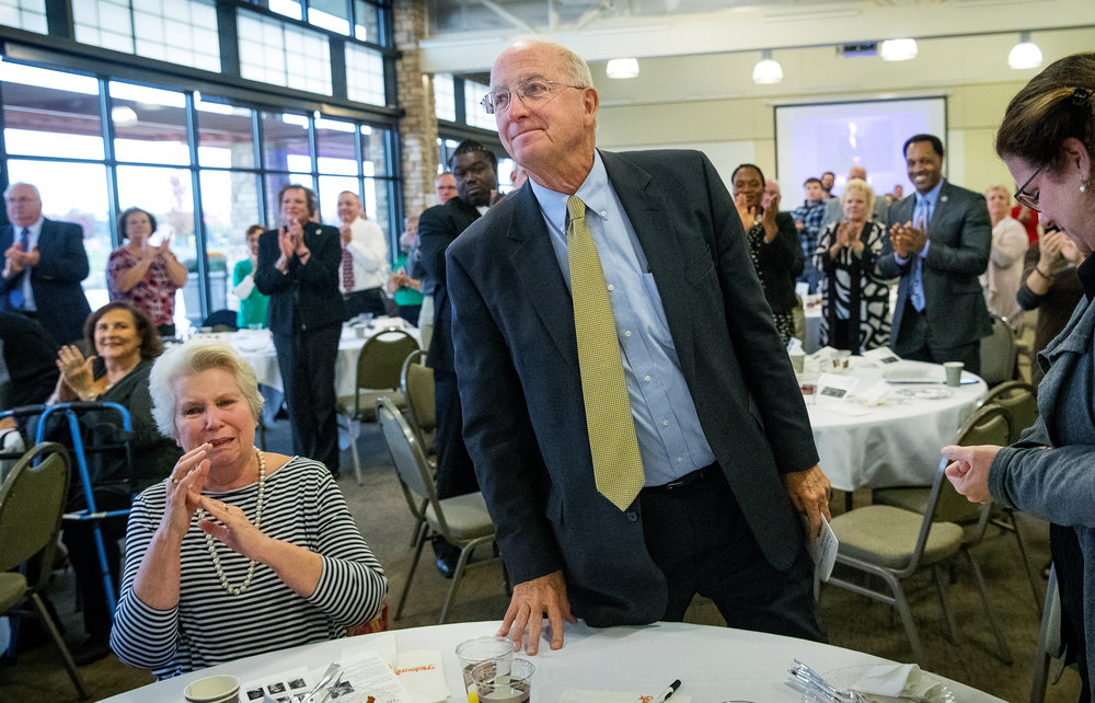 John Eck Sr. stands as guests applaud after he was named The State Journal-Register's 2018 First Citizen at a ceremony at Erin's Pavilion in Southwind Park Thursday, Oct. 25, 2018. Eck's wife Linda is at left. [Ted Schurter/The State Journal-Register]