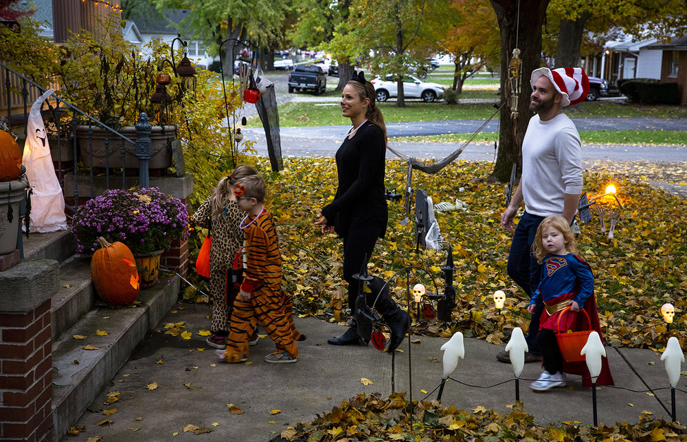 Jill and Matt Giacominni and their kids, Violet and James, left, and Ruby Selinger, trick or treat on East Harpole Street Wednesday, Oct. 31, 2018 in Williamsville, Ill. [Rich Saal/The State Journal-Register]
