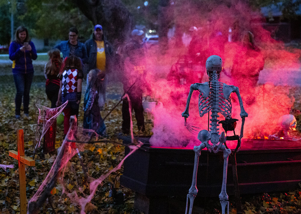 A haunted graveyard in the front yard of Ryan and Kara McCaffrey's home attracts the attention of trick or treaters Wednesday, Oct. 31, 2018 in Williamsville, Ill. [Rich Saal/The State Journal-Register]