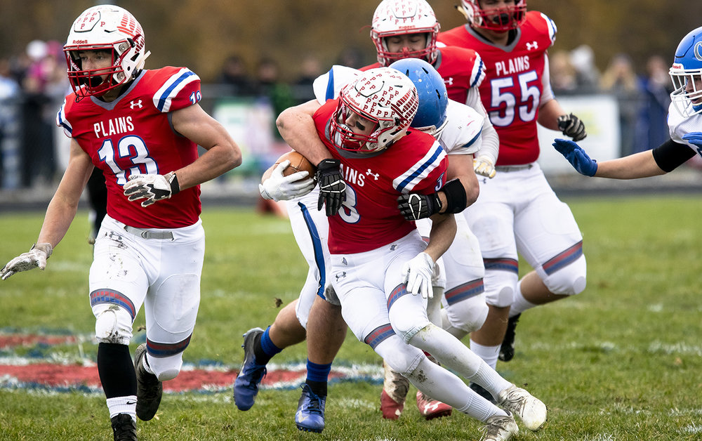 Pleasant Plains' Keigan Halford struggles to escape the grasp of Greenville's Tanner Tomaschke in the Class 2A playoff game Saturday, Nov. 3, 2018 at Pleasant Plains High School in Pleasant Plains, Ill. [Rich Saal/The State Journal-Register]