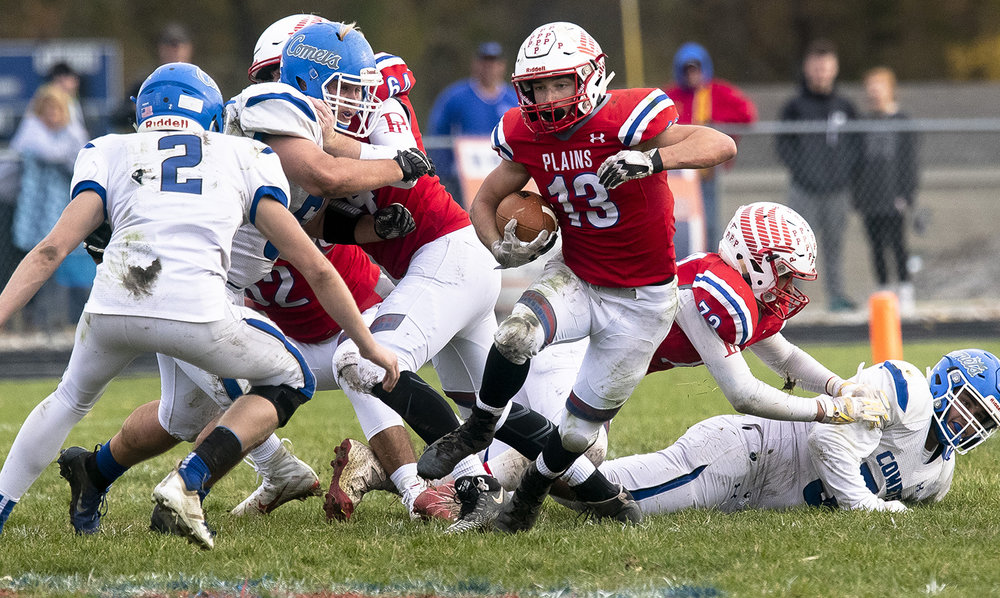 Pleasant Plains' Lucas Western breaks through the Greenville defense during the Class 2A playoff game Saturday, Nov. 3, 2018 at Pleasant Plains High School in Pleasant Plains, Ill. [Rich Saal/The State Journal-Register]