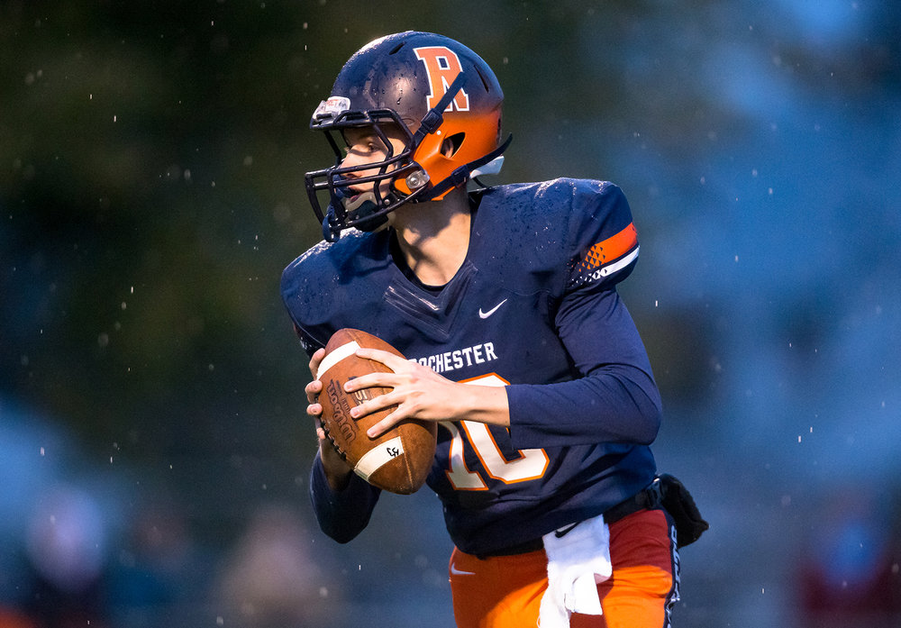 Rochester quarterback Brock Mackiney (10) drops back looking for an open receiver against Pontiac in the first half in the second round of the Class 4A playoffs at Rochester High School, Saturday, Nov. 3, 2018, in Rochester, Ill. [Justin L. Fowler/The State Journal-Register]