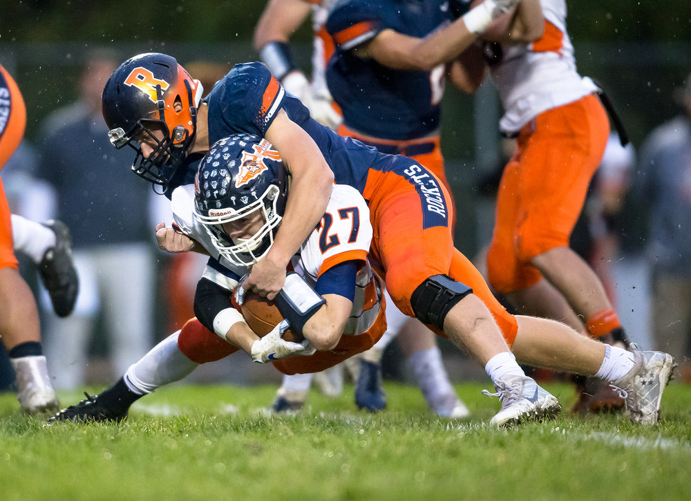 Pontiac's Austin Norman (27) is stopped on a rush by Rochester's Nick Davis (20) in the first half in the second round of the Class 4A playoffs at Rochester High School, Saturday, Nov. 3, 2018, in Rochester, Ill. [Justin L. Fowler/The State Journal-Register]
